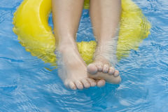 Childre in paddling pool. Little girls playing in th blue paddling pool Royalty Free Stock Photo
