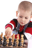 Childre playing chess Stock Images