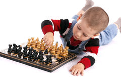 Childre playing chess Stock Photos