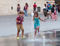 Childre plays with water. This children is from Valetta and they play with the fontaine Royalty Free Stock Photo