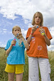 Childrem blowing bubbles Royalty Free Stock Image