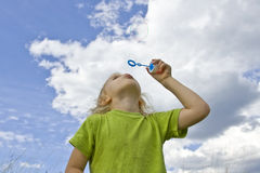 Childrem blowing bubbles Stock Photos