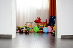 Children's multicolored toys on wooden floor or carpet on kids room