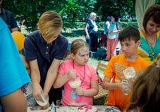 Children – boys and girl - participating at anti-stress toy creation workshop. Zaporizhia/Ukraine- June 2, 2018: – boys and girl - participating at stock photos