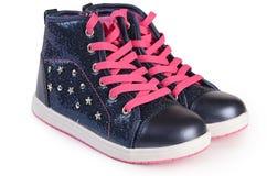Children& x27 του s πάνινα παπούτσια που απομονώνονται μοντέρνα στο λευκό Στοκ εικόνα με δικαίωμα ελεύθερης χρήσης