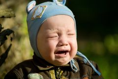 Children. Cute crying children in outdoor Royalty Free Stock Photography