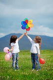 Children. Cute happy children playing in spring filed Royalty Free Stock Photos