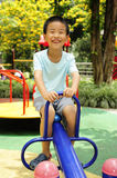 A children. A child playing on playground stock photos