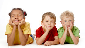 Children. Image of funny children lying down and posing to camera royalty free stock photos