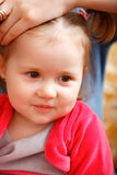 Children. The portrait of the little girl which lovely smiles and fervently laughs Stock Photography