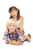 Children. Two little children sitting embrace and smile, on white background stock image