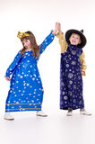 Children. Little boy dressed as an astrologer and a little girl dressed as stars stock images
