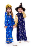 Children. Little boy dressed as an astrologer and a little girl dressed as stars Royalty Free Stock Image