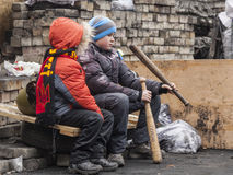 Children. Holding hands in bits and military helmets, sitting on a barricade in Ukraine, Kiev the revolutionary events on the change of power in the country stock images