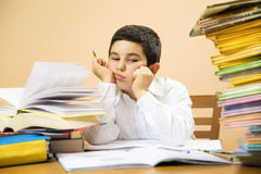 Children. Little boy getting bored of his homeworks Stock Photos