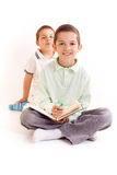 Children. Young man read from book Stock Photo