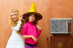 Children 70s two kid friend girls in retro party. Children 70s two kid friend girls in party with retro wood tv stock photos