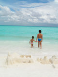 Children. Two children on the beach swimming Royalty Free Stock Photos