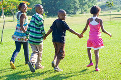 Children. African children running in the park Stock Images