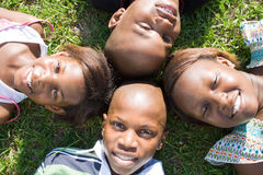 Children. African brothers and sisters children lying on grass Stock Photo