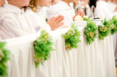 Children accepting first Holy Communion Royalty Free Stock Photography