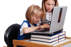 Children activities on laptop put on desk Royalty Free Stock Image