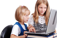 Children activities on laptop put on desk isolate Stock Images