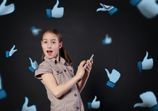 Children addiction to social networks. Little girl with mobile. Children addiction to social networks. Portrait of little girl surprised touching screen of Royalty Free Stock Images