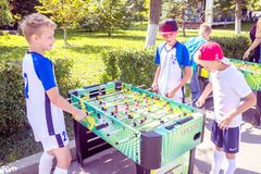 Children, adolescents, play table football on the Volga River Embankment on a sunny summer day. Russia, Samara, August, 2018: children, adolescents, play table royalty free stock images