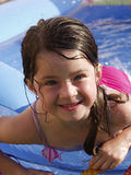 Children-Adorable Girl Swimming. Adorable little girl swimming in a backyard pool stock photos
