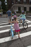 Children and an adult crossing the street Stock Photos