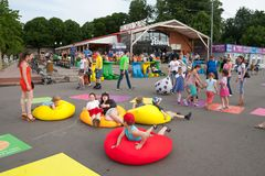 Children and adults playing and lying on inflatable mattresses Stock Images