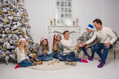 A young family with children are preparing to celebrate Christmas Royalty Free Stock Photo