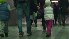 Children and adults walking through underpass, people traveling, slow-motion. Stock footage stock video