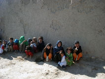 Children in Afghanistan. This image represents poor people and children in Afghanistan standing on the street Stock Photography