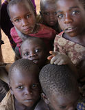 Children in Africa. African children staring at the camera in Uganda, near the border with Rwanda stock photo