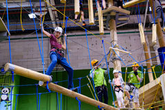 Children age 6-12 attend indoor adventure climbing park. Moscow, Russia - September 10, 2016: Children age 6-12 attend indoor adventure climbing park at day time Stock Images