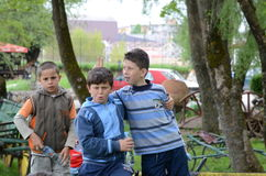 Children at the age of seven or eight playing in an amusement park Stock Photography