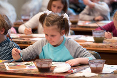 Children aged 6-9 years attend free drawing workshop during the open day in watercolors school Royalty Free Stock Photos