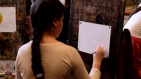 Children aged 6-9 years attend free drawing workshop during the open day in watercolors school stock video