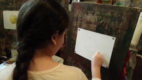 Children aged 6-9 years attend free drawing workshop during the open day in watercolors school stock video footage