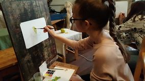 Children aged 6-9 years attend free drawing workshop during the open day in watercolors school stock footage