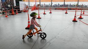 Children aged 4-6 years are racing on bicycles during Velo Park 2017 exhibition stock video footage
