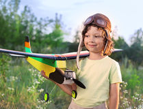 Children with airplan toy. Children with hand made airplan toy outdoors Royalty Free Stock Photography