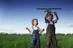 Children with airplan toy. Outdoors royalty free stock image