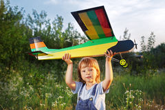 Children with airplan toy. Outdoors Stock Photography
