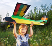 Children with airplan toy. Outdoors Stock Image