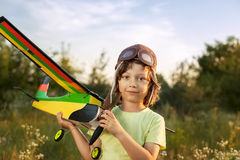 Children with airplan toy outdoors Royalty Free Stock Images