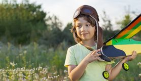 Children with airplan toy outdoors. Happy children with airplan toy outdoors airplane is hand made not copyright stock photo