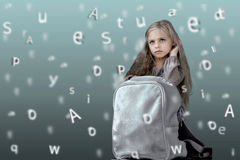 Children. alphabet. cute little girl with school backpack on the background of the emerging letters Stock Image